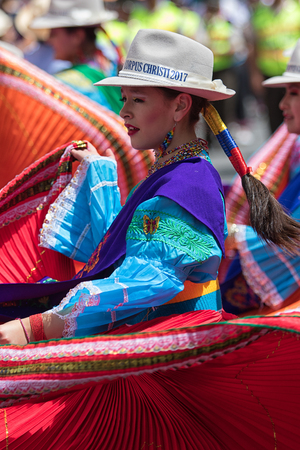 June 17, 2017 Pujili, Ecuador: young female dancer in traditional wear performing on the street at Corpus Christi celebrations