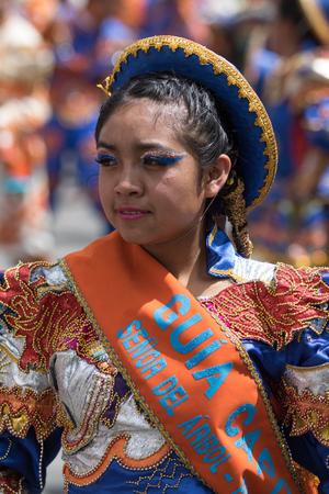 June 17, 2017 Pujili, Ecuador: closeup detaisl of a kichwa indigenous young woman dancing in a colorful traditional dress at Corpus Christi parade Editorial