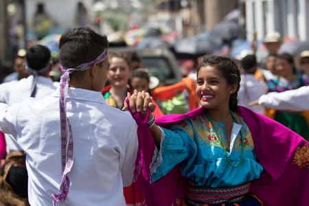 June 17, 2017 Pujili, Ecuador: young indigenous dancers in traditional clothing during Corpus Christi parade