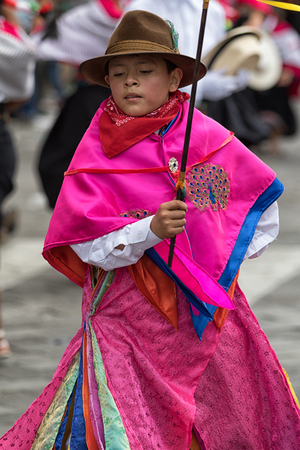 June 17, 2017 Pujili, Ecuador: young indigenous boy in bright color traditional clothing at Corpus Christi parade Editorial