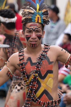 June 17, 2017 Pujili, Ecuador: closeup of a male dancer from he Amazon area at the Corpus Christi annual parade Editorial