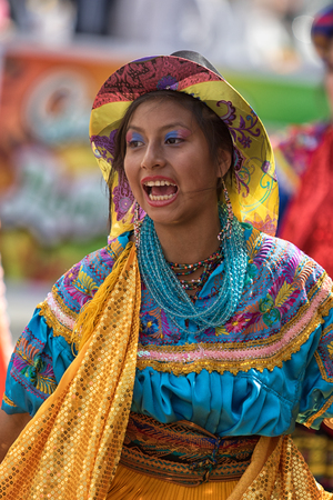 June 17, 2017 Pujili, Ecuador: closeup of a male dancer with colorful traditional clothing  at the Corpus Christi annual parade