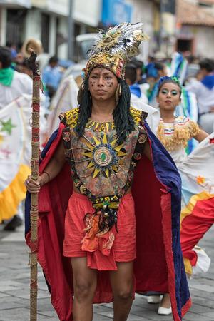 June 17, 2017 Pujili, Ecuador: male participant in colorful costume at the Corpus Christi annual parade