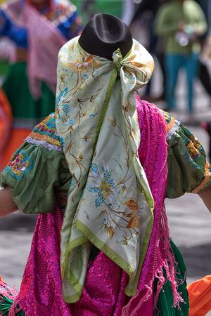 June 17, 2017 Pujili, Ecuador:traditional female dress details worn at the Corpus Christi annual parade