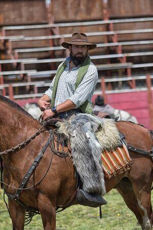 June 10, 2017 Toacazo, Ecuador: local cowboy on horseback wearing alpaca chaps in the rodeo arena Editöryel