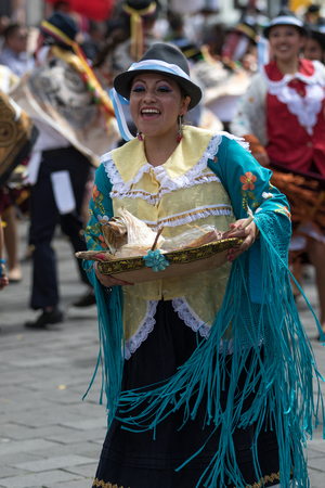 June 17, 2017 Pujili, Ecuador: female dancer in traditional clothing in motion at the Corpus Christi annual parade