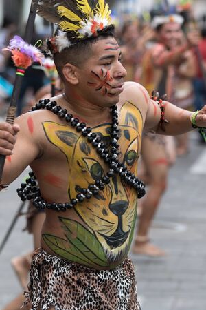 June 17, 2017 Pujili, Ecuador: male dancer from he Amazon area at the Corpus Christi annual parade