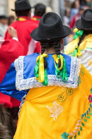 June 17, 2017 Pujili, Ecuador: female indigenous clothing details at the Corpus Christi annual street parade in the Andean town