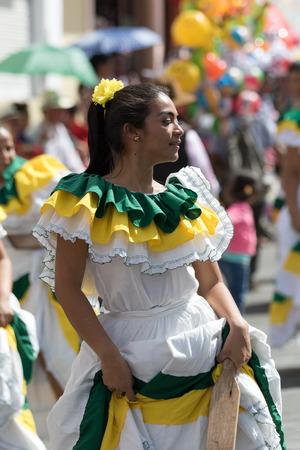 June 17, 2017 Pujili, Ecuador: closeup of a female dancer with colorful traditional clothing  at the Corpus Christi annual parade