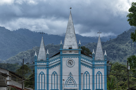 Cotundo, Ecuador; small colorful church in the center of the tropical town known for its petroglyphs Stock Photo - 87784183