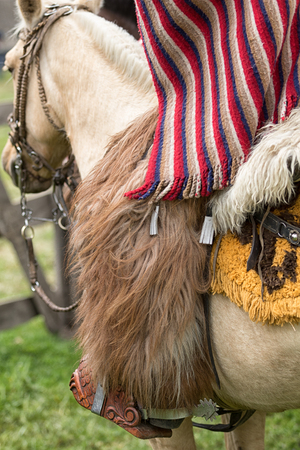 Machachi, Ecuador: closeup traditional chaps and poncho cowboy wear in the Andes