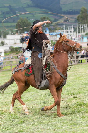June 3, 2017 Machachi, Ecuador: closeup of Andean cowboy on horseback  dressed traditionally on horseback working in field