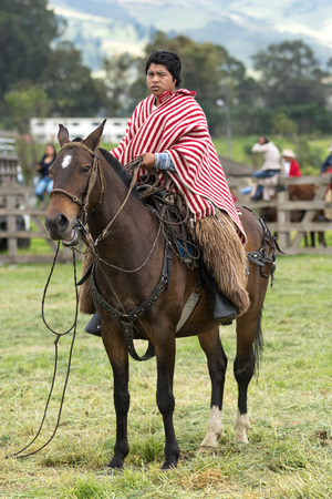 June 3, 2017 Machachi, Ecuador: Andean cowboy on horseback wearing chaps and poncho