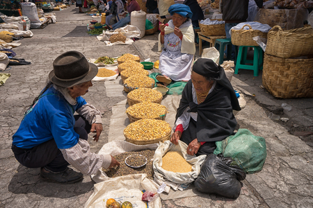 April 29, 2017 Otavalo, Ecuador: indigenous quechua people selling prduce from the ground on the street in the Saturday market