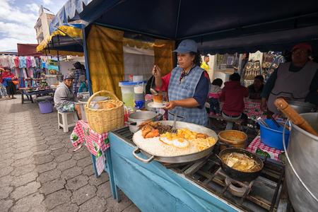 April 29, 2017 Otavalo, Ecuador: indigenous quechua women are preparing food on the street in the Saturday market Stock fotó - 87458964