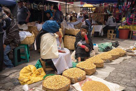 April 29, 2017 Otavalo, Ecuador: indigenous quechua women selling grains on the street in the Saturday market Sajtókép