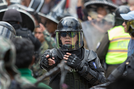 June 24, 2017 Cotacachi, Ecuador:  riot police sorting out an altercation during the Inti Raymi parade