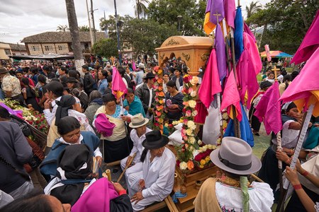 April 14, 2017 Cotacachi,Ecuador: people taking a break from Easter procession in the center of the town 報道画像