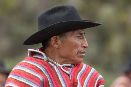 local 27: May 27, 2017 Sangolqui, Ecuador: closeup off a local cowboy wearing traditional wool poncho watching the rural rodeo Editorial