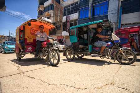 March 19, 2017 Tumbes, Peru: three wheeled converted motorcycle taxis in the hot tropical town