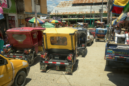 March 19, 2017 Tumbes, Peru: congested midday traffic in the centre of the tropical town