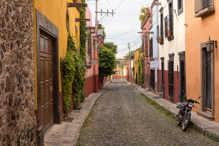 November 22, 2014 San Miguel de Allende, Mexico:  colonial buildings along narrow cobblestone streets a main feature of th epopular tourist town