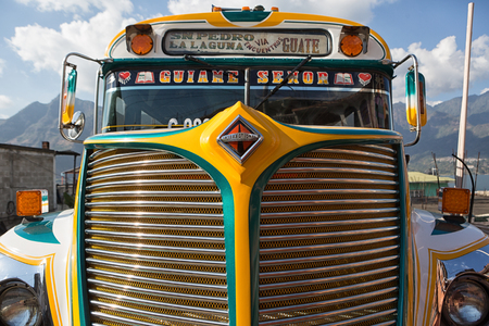 January 3, 2015 San Pedro la Laguna, Guatemala: old school buses also called chicken-bus are redecorated, painted in bright colours and refitted for public transportation Editorial
