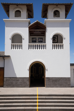 Quito, Ecuador: small whitewash architecture church built on the equator line in the Mitad del Mundo monument