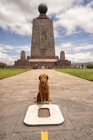 March 2, 2017 Quito, Ecuador: the monument marking the zero latitude in the Mitad del Mundo is dog friendly tourist destination