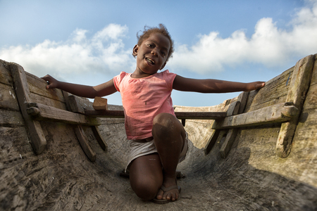 March 11, 2015 Sambo Creek, Honduras: a young garifuna girl part of the fishing community on the carribbean coast of the country inside a dugout canoe