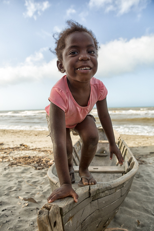 March 11, 2015 Sambo Creek, Honduras: a young garifuna girl part of the fishing community on the carribbean coast of the country stands on a dugout canoe Editorial