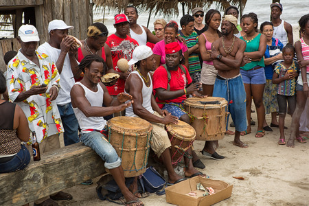 March 8, 2015 Sambo Creek, Honduras: young garifuna men playing traditional drums outdoors