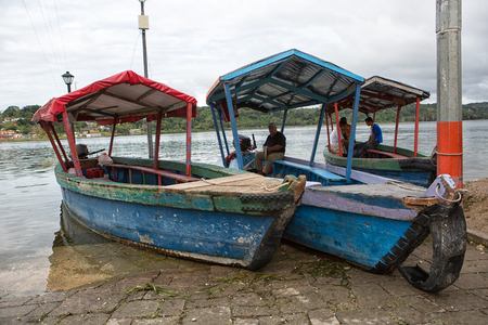 January 11, 2015 Flores, Guatemala: taxi boat waiting for customers on the shore of the popular tourist destination island