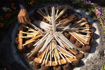 San Pedro la Laguna, Guatemala: hand arranging candles and palo santo wood for shamanic ritual