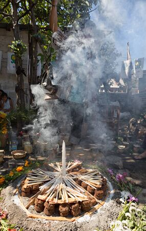 January 31, 2015 San Pedro la Laguna, Guatemala: Mayan man engulfed in smoke during a shamanic ritual