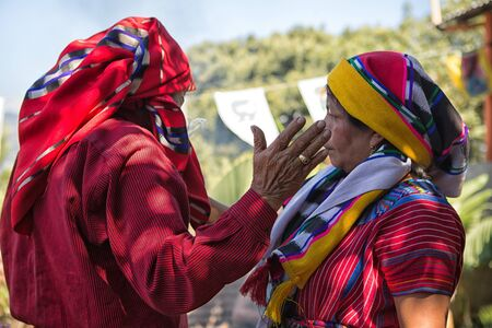 January 31, 2015 San Pedro la Laguna, Guatemala: tata Pedro Cruz one of the last authentic elderly Mayan shamans performing ritual witha woman