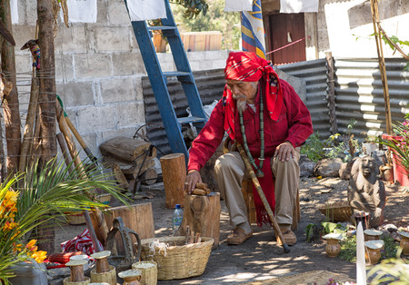 January 31, 2015 San Pedro la Laguna, Guatemala: tata Pedro Cruz one of the last authentic elderly Mayan shamans getting ready to perform a ritual