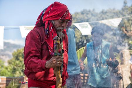 January 31, 2015 San Pedro la Laguna, Guatemala: tata Pedro Cruz one of the last authentic elderly Mayan shamans performing ritual with a younger man