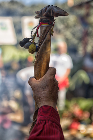 San Pedro la Laguna, Guatemala: hand of an authentic Mayan shaman holding a cane during a ceremony