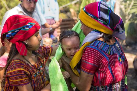 January 31, 2015 San Pedro la Laguna, Guatemala: mayan child is baptized at a shaman ritual