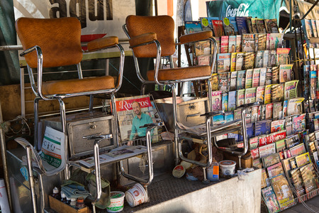 December 17, 2014 San Cristobal de las Casas, Mexico: newstand combined with shoepolish service in the historic cetre of the popular colonial tourist destination town