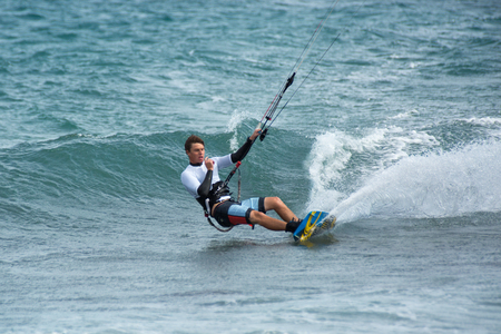 January 25, 2014 Los Barriles, Mexico: kiteboarder carves a turn on rough water at the Lord of the Wind kite surf competition