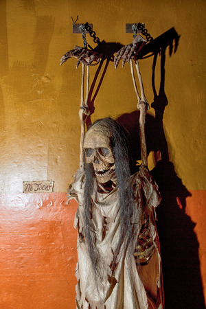 May 20, 2014 Zacatecas, Mexico: puppet chained to the wall as example in the inquisition and torture museum