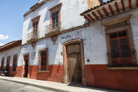 adobe wall: March 25, 2014 Patzcuaro, Mexico: the town kept its traditional colonial look over time, serving as a market hub for the region Editorial