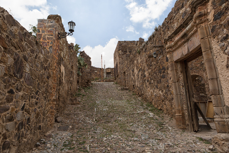 May 22, 2014 Real de Catorce, Mexico: the stone built houses along the cobblestone streets are mostly abandoned an in ruins and has a Pueblo Magico designation awarded