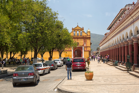 April13, 2014 San Cristobal de las Casas, Mexico: cars lining up on the street in the historic center of the colonial tourist town