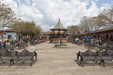 March 22, 2014 Santa Clara del Cobre, Mexico: the tcenter of the own known for its coppersmith industry, even the outdoors benches in the park are made of copper