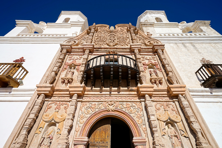 the facade of San Xavier del Bac mission in Tucson Arizona