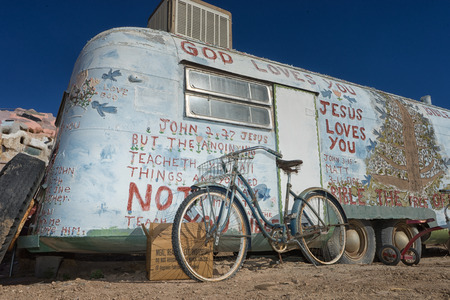 November 17, 2015 Niland, California, USA: a bike leaning against a decorated trailer at Salvation Mountain, proclaimed national treasure