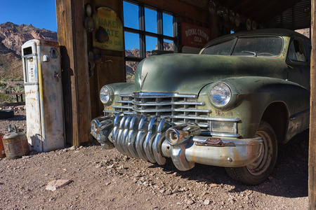 November 7, 2015 Nelson, Nevada, USA: a vintage vehicle seen parked parked in an old garage at the abandoned ghost mining town Editorial